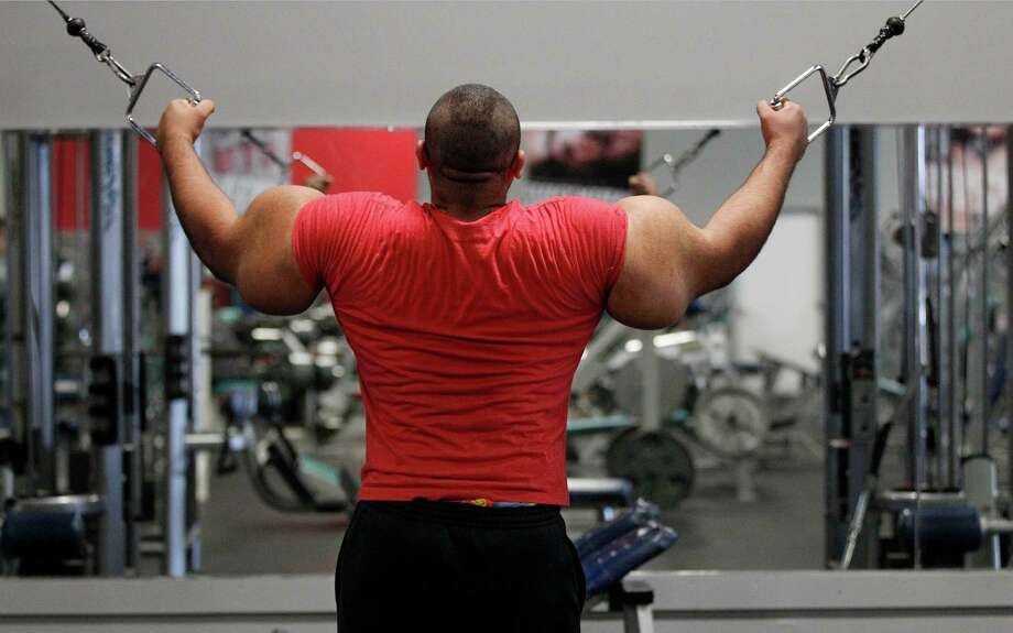 In this photo taken, Friday, Nov. 16, 2012, Egyptian Body builder Moustafa Ismail trains during his daily workout at World Gym in Milford, Mass. Ismail has been given the title of world's biggest arms, biceps and triceps, by the Guinness Book of World Records. Photo: Stephan Savoia, AP / AP