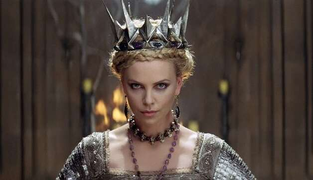 Actress Charlize Theron in a scene from the film Snow White and the Hunstman. (AP Photo/Univeral Pictures)