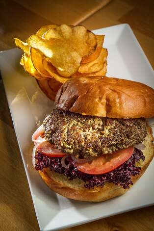 The Uptown Burger has sesame aioli, pickled onions and house-made potato chips. Photo: John Storey, Special To The Chronicle
