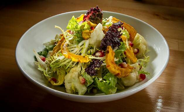 The Little Green Salad features two types of lettuce with butternut squash, cauliflower, endive and pomegranate seeds. Photo: John Storey, Special To The Chronicle