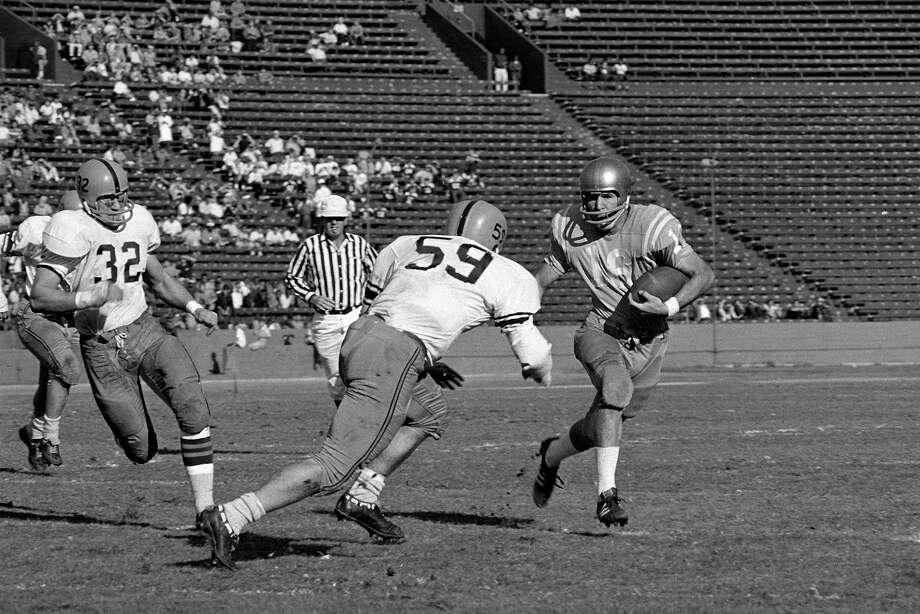 1967: Gary Beban  School: UCLA Position: QB  Class: Senior  Photo: File Photos