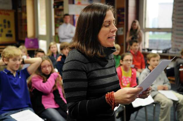 "New Canaan Country School fifth-grade teacher Kristen Ball speaks to her students during an attempt at video-chatting with students in Tanzania. Due to a lack of reliant electricity the Tanzanian class had difficulty connecting to the internet, so brief waves to each other were all that the students could share on Thursday, November 29, 2012. The American students translated their questions into Swahili and practiced speaking the language while they waited. Student Molly Connors said she was a little disappointed they didn't get to chat this time but the experience taught a lesson. ""Well, I mean, it was a little disappointing but we also got to learn how they feel on the other end too, because this doesnâÄôt usually get to happen for them and itâÄôs lucky that we get to talk to them,"" she said. Photo: Lindsay Niegelberg / Stamford Advocate"
