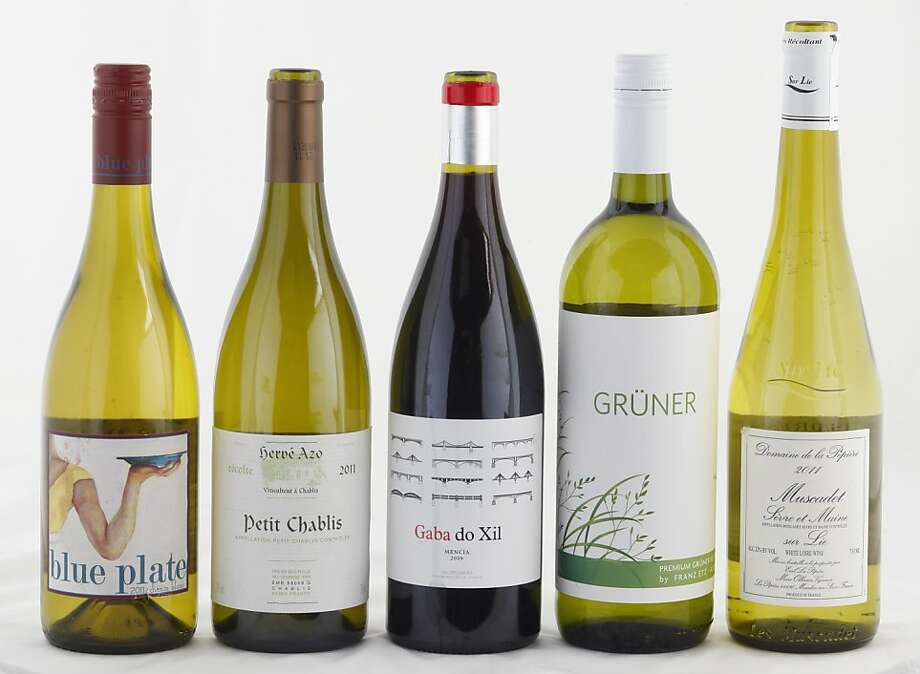 Left-right: 2011 Blue Plate Chenin Blanc, 2011 Herve Azo Petit Chablis, 2009 Gaba do Xil red wine, 2011 Franz Etz Gruner Veltliner, 2011 Domaine de la Pepiere Muscadet Photo: Craig Lee, Special To The Chronicle