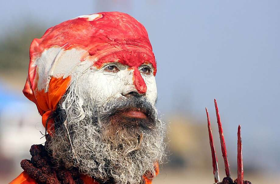 Face of devotion:A Hindu holy man, or sadhu, worships on the banks of the Sangam, the confluence of the Ganges, Yamuna and mythical Saraswati rivers in Allahabad, India. Every 12 years, during the Maha Kumbh Mela, millions of devotees gather to bathe in the holy waters of the three rivers. Photo: Sanjay Kanojia, AFP/Getty Images