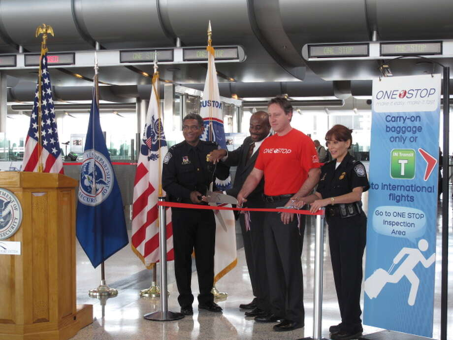 From left, U.S. Customs and Border Protection port director Terry Estell; Houston Airport System COO Lance Little; Tim Joniec, Houston Air System director of Government Affairs and International Business Development; and CBP Chief Alma Montemayor cut the ribbon recognizing the new construction for the One-Stop pilot program here. Photo taken 11/29/2012 Photo: U.S. Customs & Border Protection
