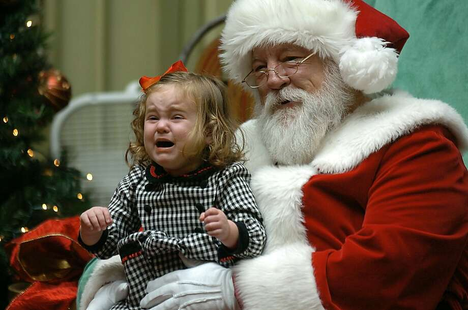 In no mood for merriment:Rose Morrison, 2, visits Santa at the Viewmont Mall in Dickson, Pa., and is scarred for life. Photo: Butch Comegys, Associated Press