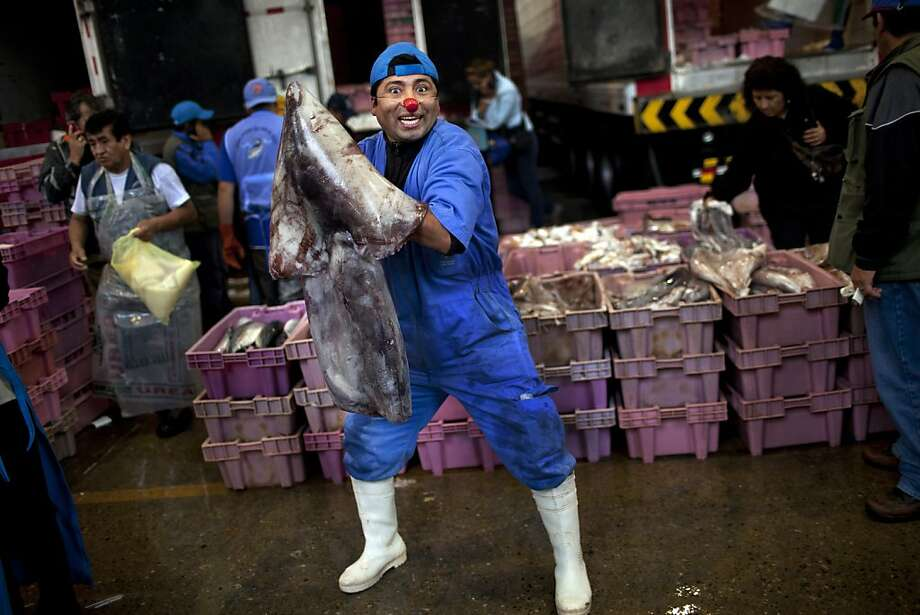 """Albert the red-nosed fish monger had a very shiny nose: And if you ever saw him, you would even say """"pretty good marketing gimmick, Albert."""" (Villa Maria del Triunfo market in Lima, Peru.) Photo: Rodrigo Abd, Associated Press"""