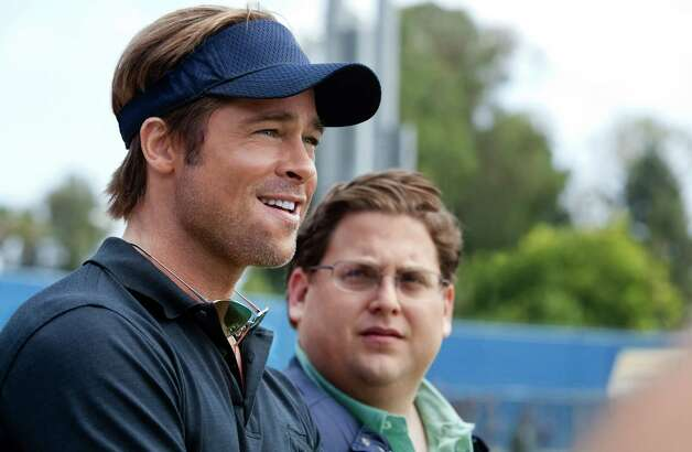 "In this image released by Sony Pictures, Brad Pitt, left, and Jonah Hill are shown in a scene from ""Moneyball.""  The film was nominated Tuesday, Jan. 24, 2012 for an Oscar for best film. Pitt was also nominated for best actor and Hill was nominated for best supporting actor. The Oscars will be presented Feb. 26 at the Kodak Theatre in Los Angeles, hosted by Billy Crystal and broadcast live on ABC. (AP Photo/Columbia Pictures-Sony, Melinda Sue Gordon) Photo: Melinda Sue Gordon / Sony"