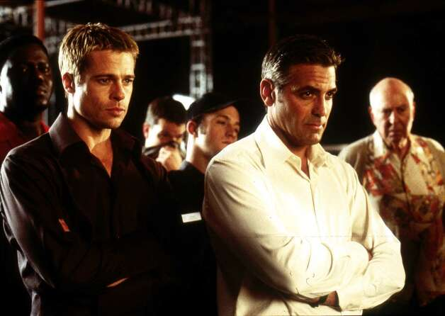 Brad Pitt (left) as Rusty Ryan and George Clooney (right) as Danny Ocean star in Warner Bros. Pictures' and Village Roadshow Pictures' OCEAN'S ELEVEN. (AP Photo/Bob Marshak). Photo: BOB MARSHAK