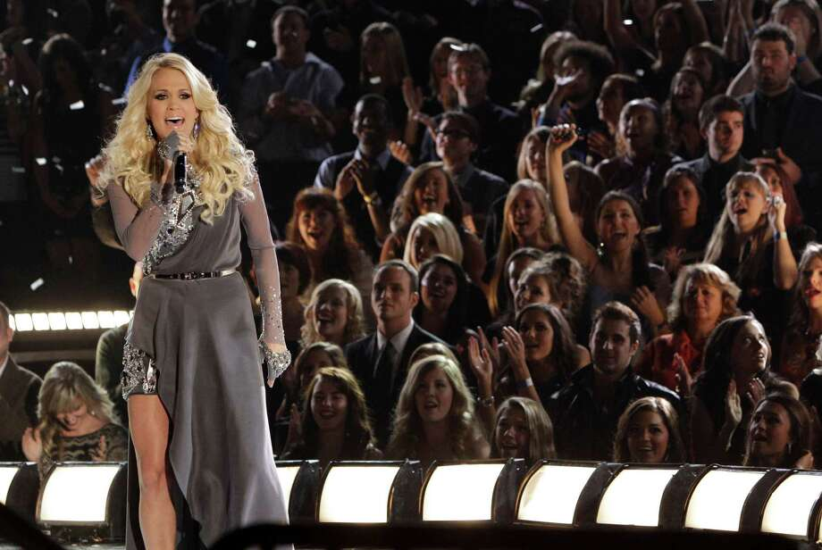 Carrie Underwood performs onstage at the 46th Annual Country Music Awards at the Bridgestone Arena on Thursday, Nov. 1, 2012, in Nashville, Tenn. (Photo by Wade Payne/Invision/AP) Photo: Wade Payne / Invision