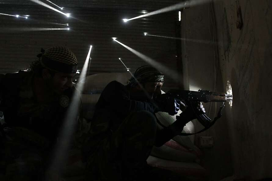 Two Syrian rebels take sniper positions at the heavily contested neighborhood of Karmal Jabl, cen