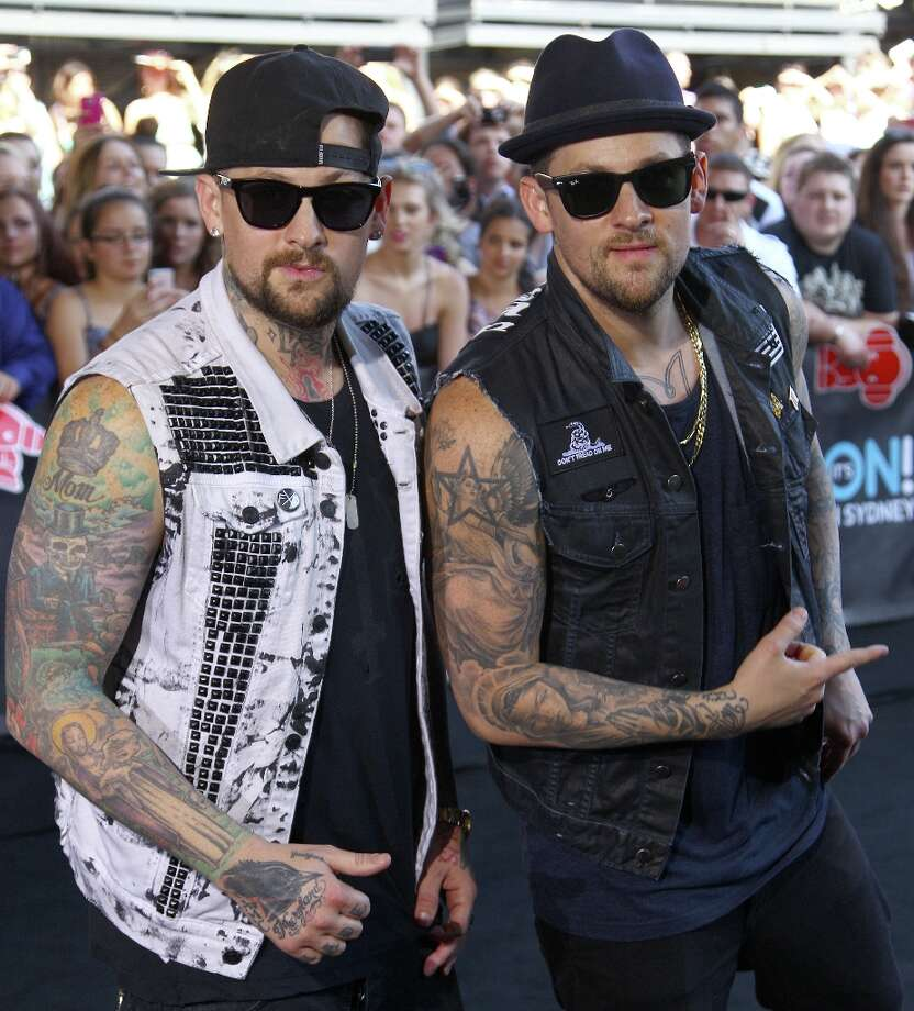 American rocker brothers Joel, right, and Benji Madden pose for photographers upon arrival for the Australian music industry Aria Awards in Sydney, Thursday, Nov. 29, 2012. (AP Photo/Rick Rycroft) Photo: Rick Rycroft, Associated Press / AP