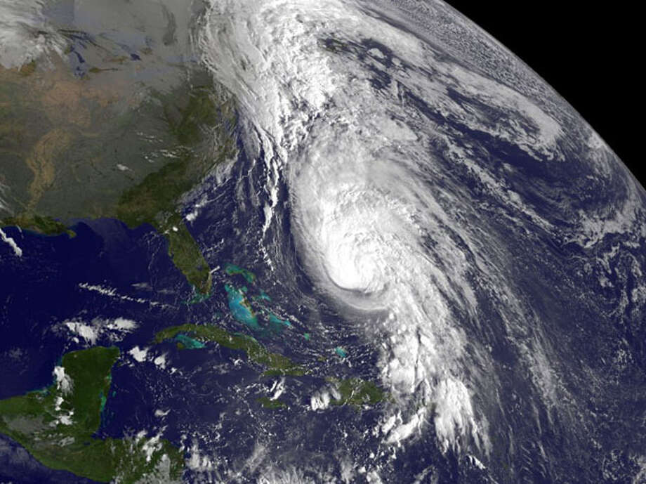 HURRICANE RAFAEL:This Category 1 storm passed near Saint Lucia on Oct 12 and Dominica as a tropical storm, passed Bermuda as an 90-mph hurricane on Oct. 16, then weakened, but transitioned into an extratropical cyclone, and later died in the Atlantic.  Photo: .