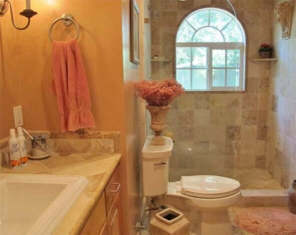 The hall bathroom features an arched window. Photo: Kelley Eling