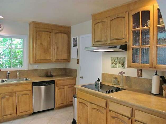 Stainless steel appliances are a byproduct of a recent remodel in the kitchen. Photo: Kelley Eling