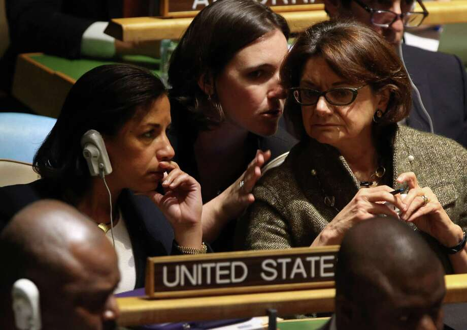 """Susan Rice, left, the U.S. ambassador to the United Nations, sits with members of the U.S. delegation ahead of the vote in New York City. Rice was critical of the vote, saying, """"Today's unfortunate and counterproductive resolution places further        obstacles in the path peace."""" Photo: John Moore, Getty Images / 2012 Getty Images"""