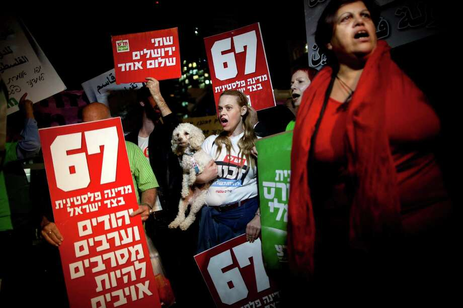 Israeli left wing activists support the Palestinian U.N. bid for observer state status, during a rally in Tel Aviv, Israel, Thursday. Photo: Oded Balilty, Associated Press / AP