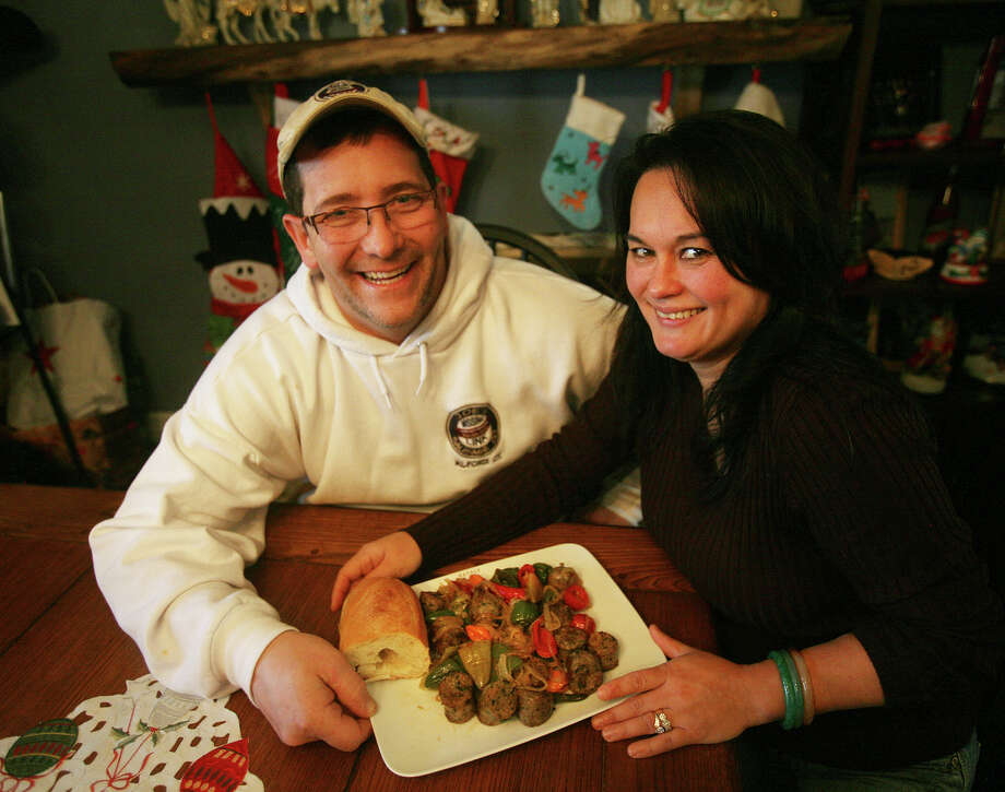 Joe and Linda DellaMonica of Milford with a plate of broccoli rabe sausage with hot peppers and onions, on Thursday, November 29, 2012. DellaMonica started the sausage making business, Joe's Missing Link Sausage Company. Photo: Brian A. Pounds / Connecticut Post