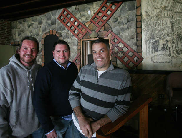 From left; Co-owners Ray Foote, Larry LaConte, Jr., and John Vazzano, all of Trumbull, are renovating the Windmill Tavern at 400 Hollister Street in Stratford. Photo: Brian A. Pounds / Connecticut Post