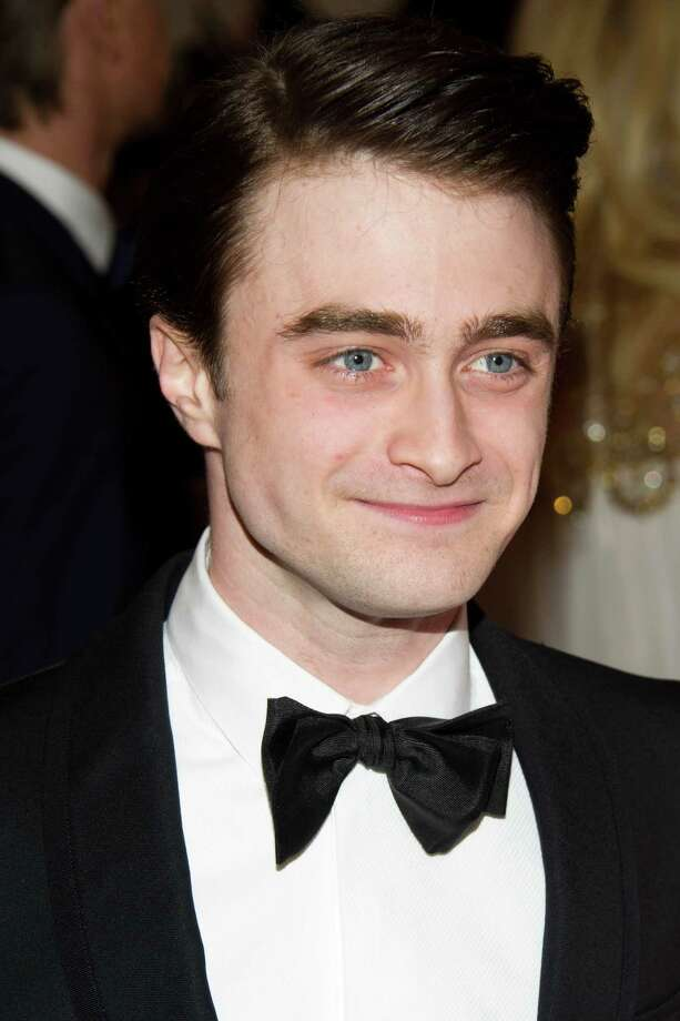 FILE - In this May 7, 2012 file photo, Daniel Radcliffe arrives at the Metropolitan Museum of Art Costume Institute gala benefit, celebrating Elsa Schiaparelli and Miuccia Prada, in New York. The ?Harry Potter? star Radcliffe has landed his first entry in the Sundance Film Festival. He plays poet Allen Ginsberg in the drama ?Kill Your Darlings,? which premieres next January at Robert Redford's Sundance festival. (AP Photo/Charles Sykes, File) Photo: Charles Sykes, FRE / AP