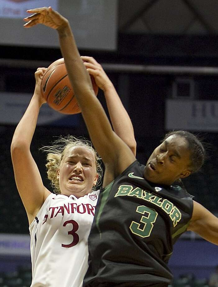 Stanford forward Mikaela Ruef snares one of her 12 rebounds in a win over then top-ranked Baylor. Photo: Marco Garcia, Associated Press