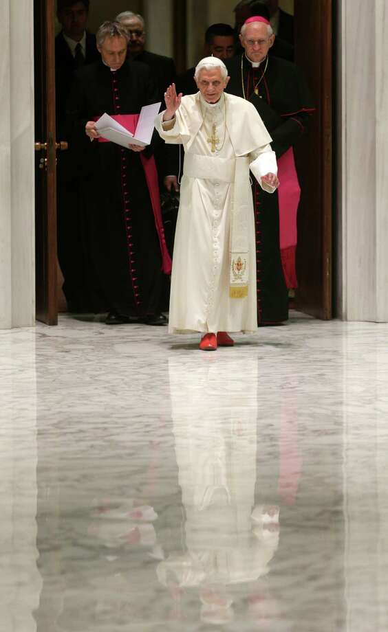 "Pope Benedict XVI waves upon his arrival for a meeting with the ""Santa Cecilia"" association, at the Vatican, Saturday, Nov. 10, 2012. Latin is being resurrected at the Vatican. Pope Benedict XVI issued a decree Saturday creating a new pontifical academy for Latin studies to try to boost interest in the official language of the Roman Catholic Church that is nevertheless out of widespread use elsewhere. Benedict acknowledged Latin's fall from grace, saying future priests nowadays often learn only a ""superficial"" appreciation of Latin in seminaries. The new academy, which is part of the Vatican's culture office, will promote Latin through conferences, publications and instruction in Catholic schools, universities and seminaries. (AP Photo/Alessandra Tarantino) Photo: Alessandra Tarantino, STF / AP"
