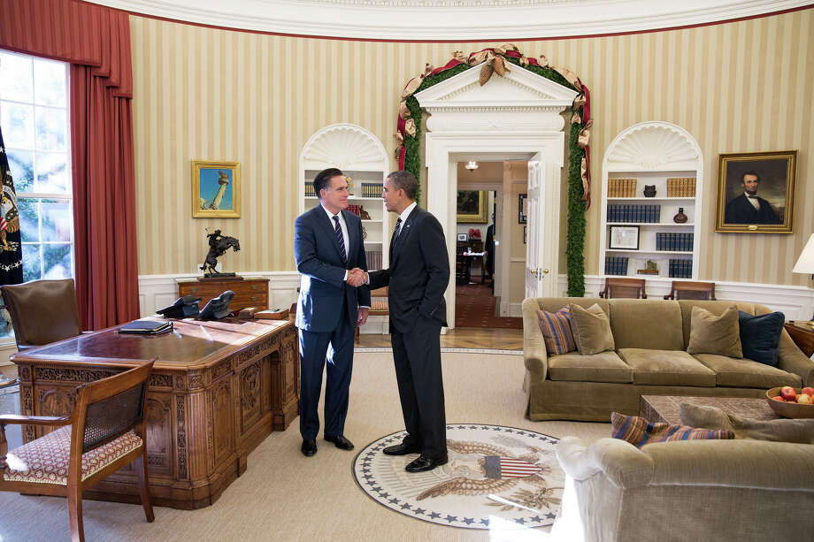 This official White House photo shows President Barack Obama and former Massachusetts Gov. Mitt Romney in the Oval Office on Thursday after their lunch of turkey chili and Southwestern grilled chicken salad. Photo: PETE SOUZA, Handout / AFP