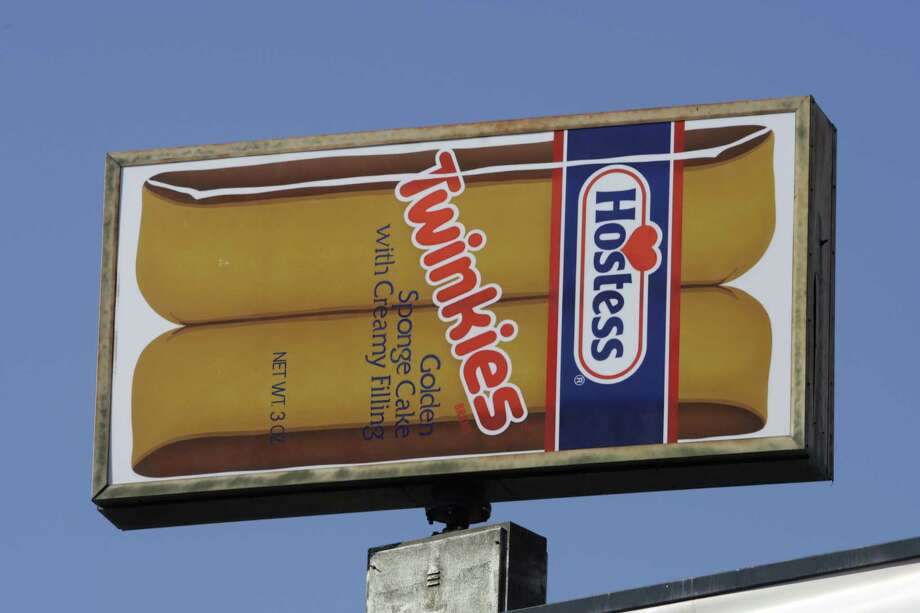 FILE - A Hostess Twinkies sign is shown at the Utah Hostess plant in Ogden, Utah, in this Nov. 15, 2012 file photo.  Hostess Brands Inc. says it's in talks with more than 100 parties interested in buying its brands, which include Twinkies, Ding Dongs and Ho Hos. (AP Photo/Rick Bowmer, File) Photo: Rick Bowmer