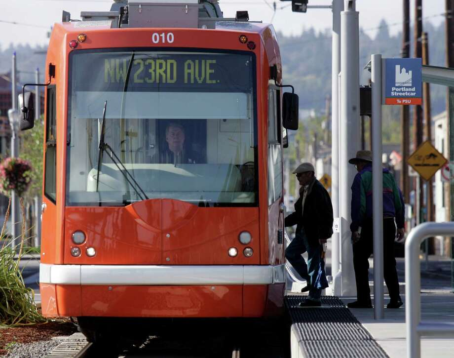 The streetcar, such as this one in Portland, Ore.,  is making a comeback in several American cities, but opponents to VIA Metropolitan Transit's proposed streetcar system say the plan is misguided. Photo: Associated Press / AP2007