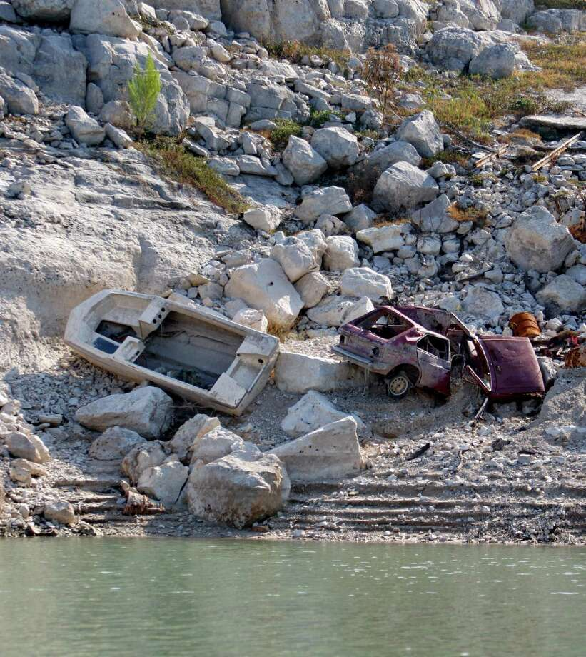 As the water level in Medina Lake continues to drop, such long-submerged items as this boat and automobile are being exposed. Photo: William Luther, San Antonio Express-News / © 2012 San Antonio Express-News