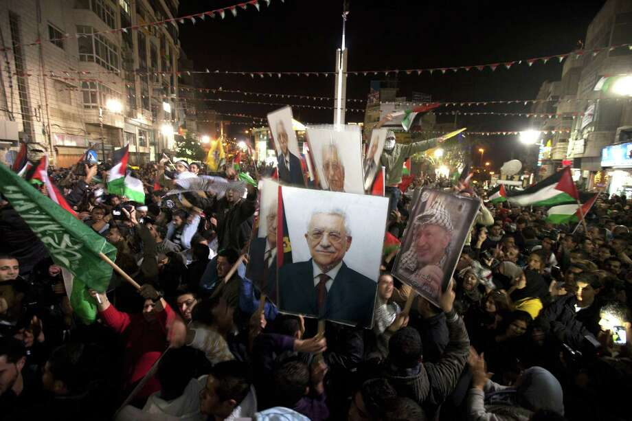 Palestinians celebrate in the West Bank city of Ramallah. Photo: AHMAD GHARABLI, AFP/Getty Images / AFP
