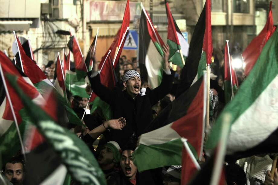 Palestinians takes to the streets to celebrate in the West Bank city of Ramallah. Photo: AHMAD GHARABLI, AFP/Getty Images / AFP