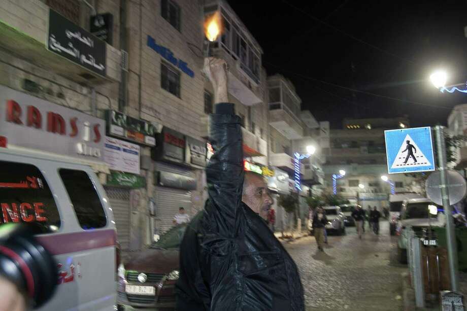 A Palestinian man fires a pistol in the air in celebration in the West Bank city of Ramallah. Despite the vote, however, the upgraded Palestinian Authority still can't introduce resolutions to        the General Assembly. Like the Vatican, the Palestinians will have to        find a sympathetic nation-state or bloc of nations in the Assembly to        introduce any resolution. Photo: AHMAD GHARABLI, AFP/Getty Images / AFP