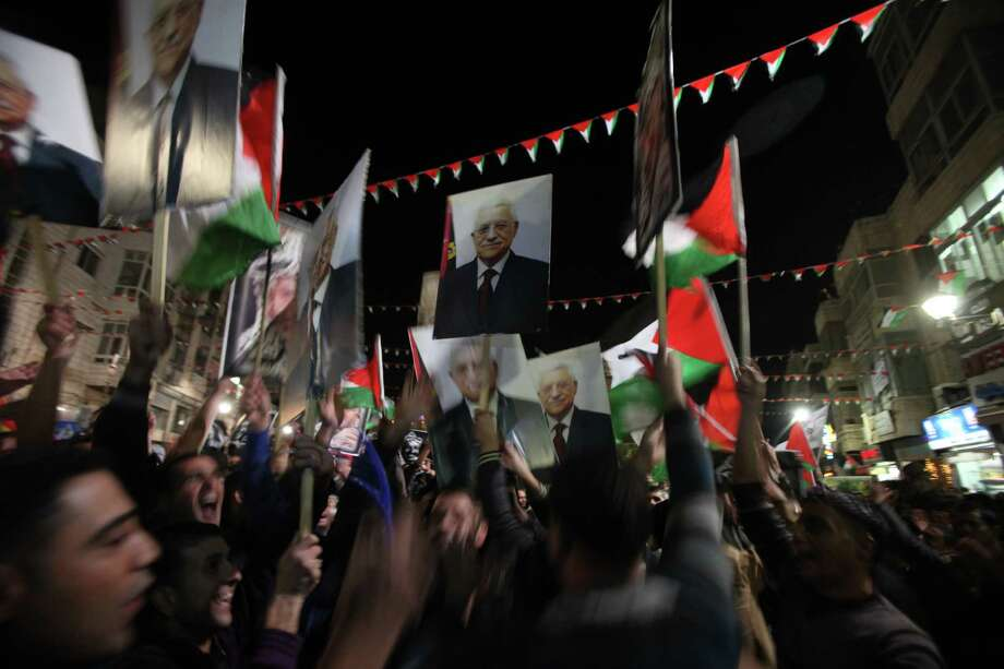 Palestinians celebrate  in the West Bank city of Ramallah on November 29, 2012 after the General Assembly voted to recognise Palestine as a non-member state.  The UN General Assembly on Thursday voted overwhelmingly to recognize Palestine as a non-member state, giving a major diplomatic triumph to president Mahmud Abbas despite fierce opposition from the United States and Israel. AFP PHOTO / ABBAS MOMANIABBAS MOMANI/AFP/Getty Images Photo: ABBAS MOMANI, AFP/Getty Images / AFP