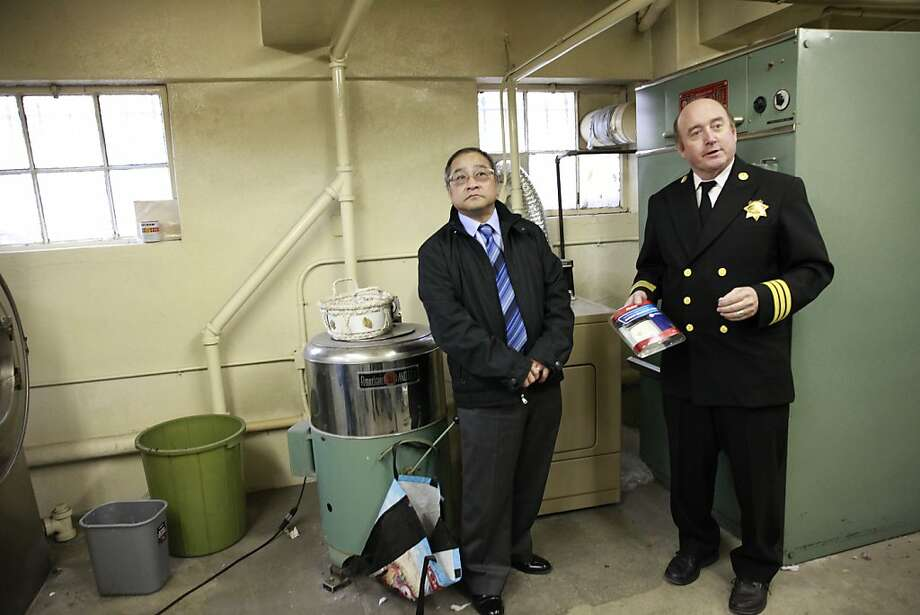 Tom Hui (left) and Fire Marshal Tom Harvey identify sources of fumes. Photo: Lea Suzuki, The Chronicle