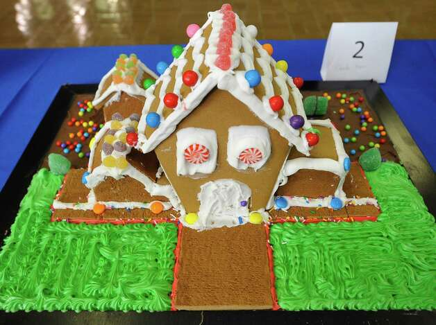 "Entry #2 is ""The Candy House.""  The Golden Triangle Chapter of the Texas Chefs Association and the Lamar University Hospitality Program are hosting the 7th Annual Gingerbread Competition Thursday November 29, 2012 with proceeds benefiting Buckner Children and Family Services. Entries were judged Thursday afternoon starting at 2 p.m. and all entries will remain on display through Sunday, Dec. 2 at the Beaumont Civic Center, located at 701 Main St. where the community is invited to view the houses and bid on them through silent auction. They were held for the first time in conjunction with the Main Street Market which opens at 5p.m. Thursday. Dave Ryan/The Enterprise Photo: Dave Ryan"