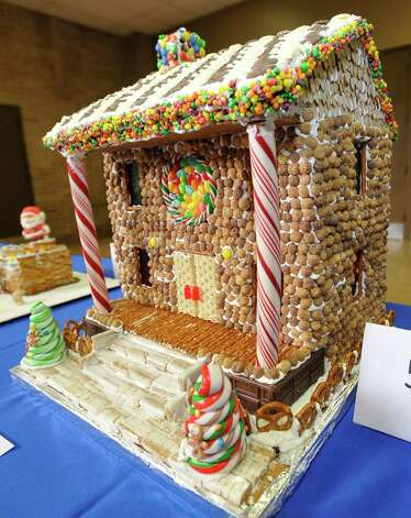 "Entry #5 is ""The Ranch House,"" which won first place in the student division. The Golden Triangle Chapter of the Texas Chefs Association and the Lamar University Hospitality Program are hosting the 7th Annual Gingerbread Competition Thursday November 29, 2012 with proceeds benefiting Buckner Children and Family Services. Entries were judged Thursday afternoon starting at 2 p.m. and all entries will remain on display through Sunday, Dec. 2 at the Beaumont Civic Center, located at 701 Main St. where the community is invited to view the houses and bid on them through silent auction. They were held for the first time in conjunction with the Main Street Market which opens at 5p.m. Thursday. Dave Ryan/The Enterprise Photo: Dave Ryan"
