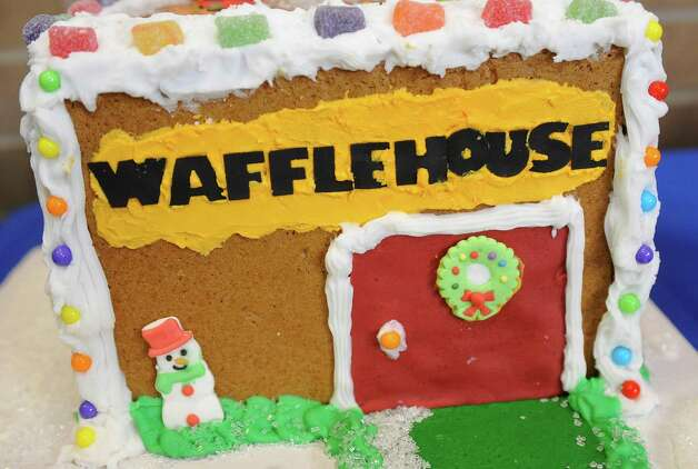 "Entry #13 is ""The Ginger Bread Waffle House.""  The Golden Triangle Chapter of the Texas Chefs Association and the Lamar University Hospitality Program are hosting the 7th Annual Gingerbread Competition Thursday November 29, 2012 with proceeds benefiting Buckner Children and Family Services. Entries were judged Thursday afternoon starting at 2 p.m. and all entries will remain on display through Sunday, Dec. 2 at the Beaumont Civic Center, located at 701 Main St. where the community is invited to view the houses and bid on them through silent auction. They were held for the first time in conjunction with the Main Street Market which opens at 5p.m. Thursday. Dave Ryan/The Enterprise Photo: Dave Ryan"