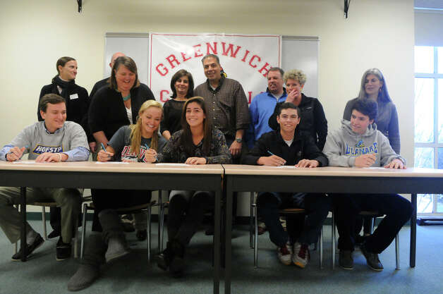 Greenwich High School athletes gather for a ceremony celebrating their signing national letters of intent for college at the high school in Greenwich, Conn., Nov. 28, 2012. From left is lacrosse players Alex Moeser and Emily Johnson, tennis player Jennifer DeLuca, golfer Danny Guise and tennis player Zachary Niklaus. Photo: Keelin Daly / Stamford Advocate Riverbend Stamford, CT