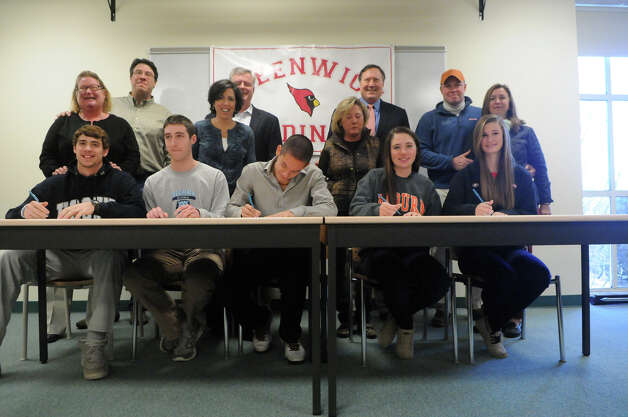 Greenwich High School athletes gather for a ceremony celebrating their signing national letters of intent for college at the high school in Greenwich, Conn., Nov. 28, 2012. From left, baseball players Taylor Olmstead and Ryan Marks, soccer player Pieter Zenner, and horseback riders Jaqueline Shilen and Emma Schauder . Photo: Keelin Daly / Stamford AdvocateRiverbendStamford, CT