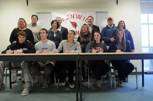 Greenwich High School athletes gather for a ceremony celebrating their signing national letters of intent for college at the high school in Greenwich, Conn., Nov. 28, 2012. From left, baseball players Taylor Olmstead and Ryan Marks, soccer player Pieter Zenner, and horseback riders Jaqueline Shileen and Emma Schowder. Photo: Keelin Daly / Stamford AdvocateRiverbendStamford, CT
