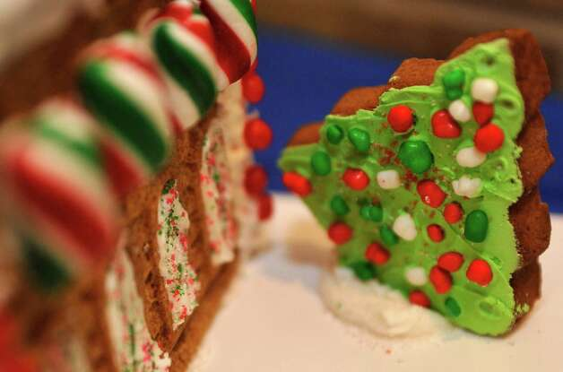 "Entry #16 is ""The Candy Crib.""  The Golden Triangle Chapter of the Texas Chefs Association and the Lamar University Hospitality Program are hosting the 7th Annual Gingerbread Competition Thursday November 29, 2012 with proceeds benefiting Buckner Children and Family Services. Entries were judged Thursday afternoon starting at 2 p.m. and all entries will remain on display through Sunday, Dec. 2 at the Beaumont Civic Center, located at 701 Main St. where the community is invited to view the houses and bid on them through silent auction. They were held for the first time in conjunction with the Main Street Market which opens at 5p.m. Thursday. Dave Ryan/The Enterprise Photo: Dave Ryan"