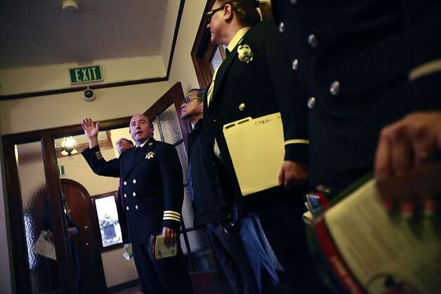 S.F. Fire Marshal Tom Harvey (left) points to an alarm that detects both smoke and carbon monoxide. Photo: Lea Suzuki, The Chronicle