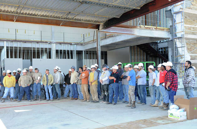 More than 80 workers break Thursday to listen to guest speakers during a tree topper ceremony at Victory Medical Center in Beaumont. Work on the $21 million structure is expected to be done in the spring of 2013. Photo taken Thursday, November 29, 2012 Guiseppe Barranco/The Enterprise Photo: Guiseppe Barranco, STAFF PHOTOGRAPHER / The Beaumont Enterprise