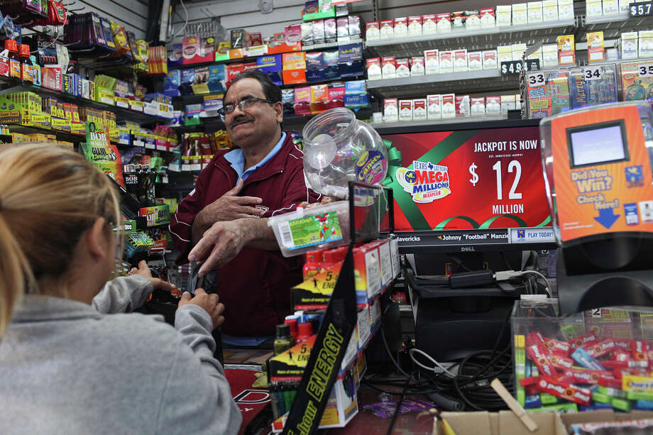 Hussain Rajab, store manager at Frio City Food Mart, talks with customers about the man who won $1 million in Wednesday's big Powerball drawing after buying a ticket at the store. The woman in the foreground said she's the winner's niece. Photo: Lisa Krantz, San Antonio Express-News / © 2012 San Antonio Express-News