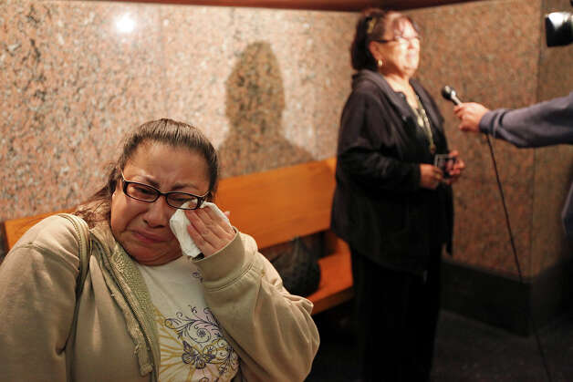 "Griselda Olivarez wipes away tears as her mother, Juanita Rodriguez, answers reporters' questions outside the 226th District Court. Olivarez's brother Francisco ""Frankie"" Rodriguez was killed last December in a road-rage shooting. Photo: Edward A. Ornelas, San Antonio Express-News / © 2012 San Antonio Express-News"