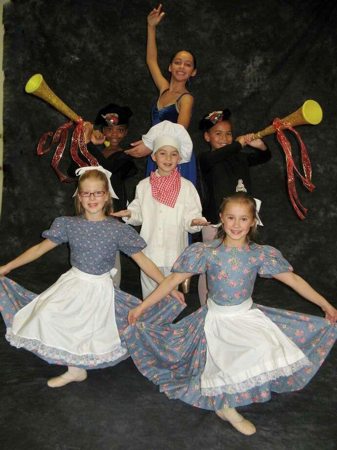 "Dancers in Connecticut Dance School's production of ""The Nutcracker"" strike a pose during a break from rehearsal. Two performances are planned Sunday, Dec. 9 at Fairfield University's Quick Center for the Arts. Photo: Contributed Photo / Fairfield Citizen contributed"