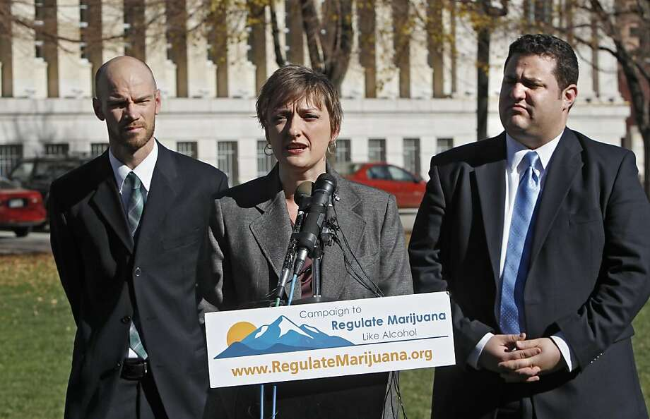 The NFL may face a dilemma in Colorado, where the Denver Broncos play and Brian Vicente (left), Betty Aldworth and Mason Tvert helped legalize pot. Photo: Ed Andrieski, Associated Press