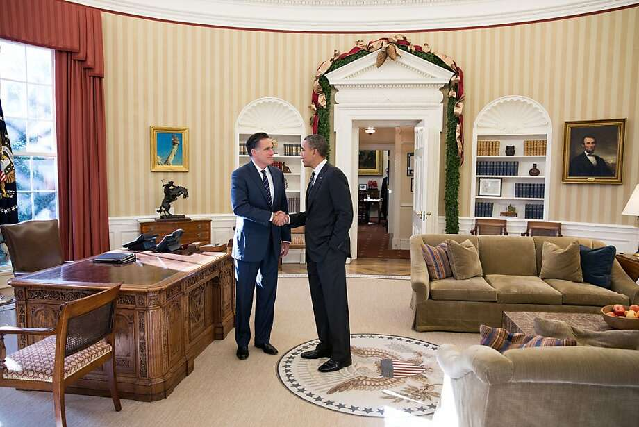 Defeated GOP candidate Mitt Romney and President Obama chat in the Oval Office after their lunch meeting. The former rivals agreed to keep in touch, according to the White House. Photo: The White House, Getty Images