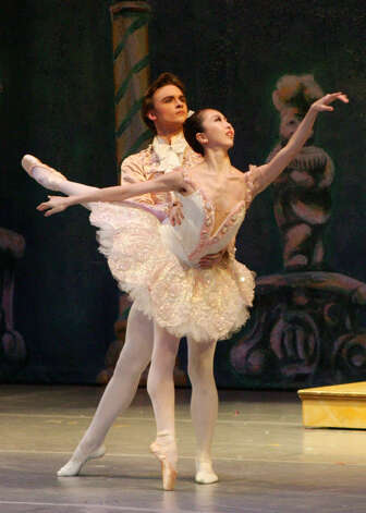 "Jared Matthews and Yuriko Kajiya, guests artists from the American Ballet Theatre, will perform as the Sugar Plum Cavalier and Sugar Plum Fairy, respectively, with the New England Ballet Company when it presents ""The Nutcracker,"" Saturday, Dec. 15, 2012, at the Klein Memorial Auditorium in Bridgeport. For more information, visit www.newenglandballet.org or call 203-799-7950. Photo: Contributed Photo"